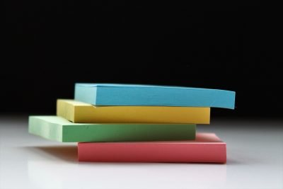 Photo of four stacks of coloured Post-its