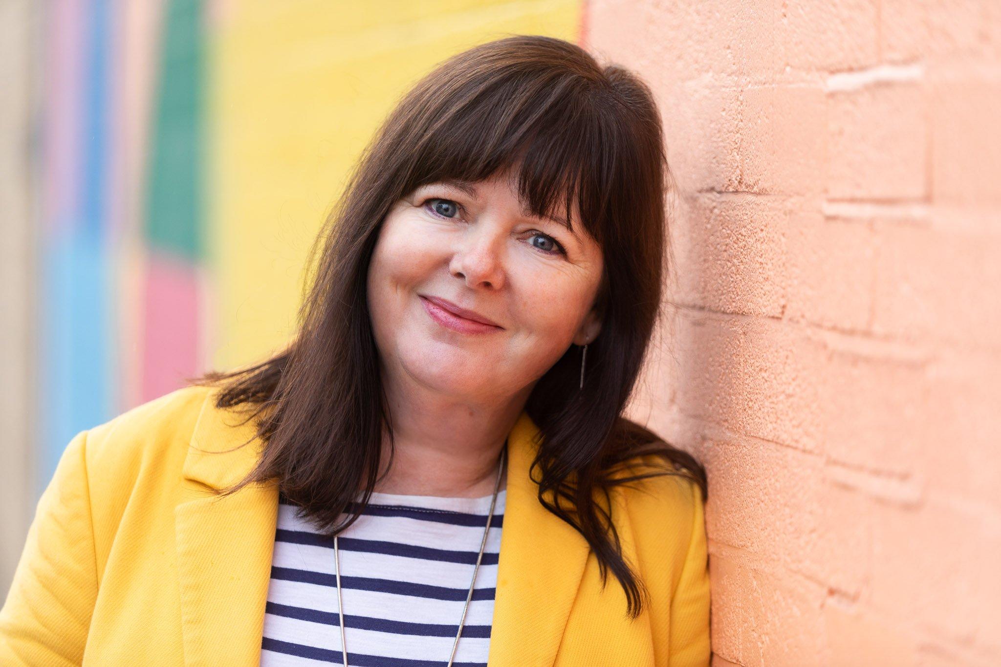 Headshot of coach and magazine publisher Angela Burgess